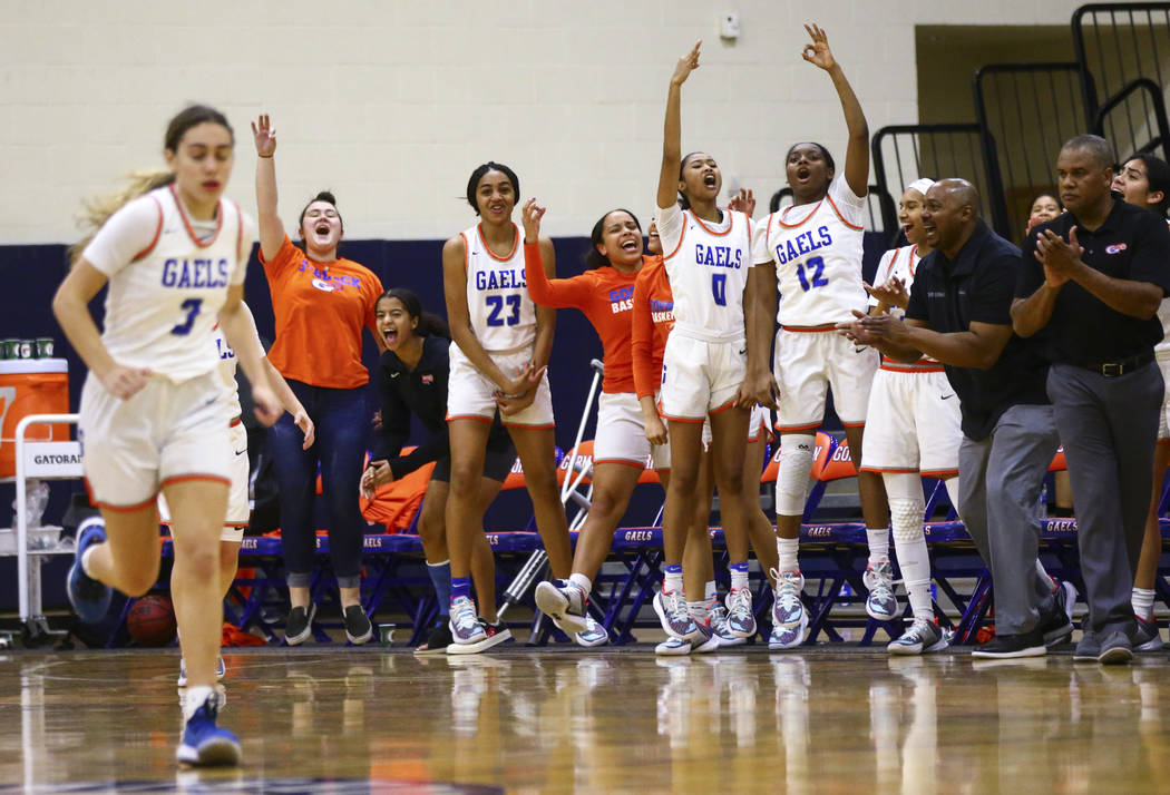 Bishop Gorman players celebrate during the second half of a basketball game against Spring Vall ...