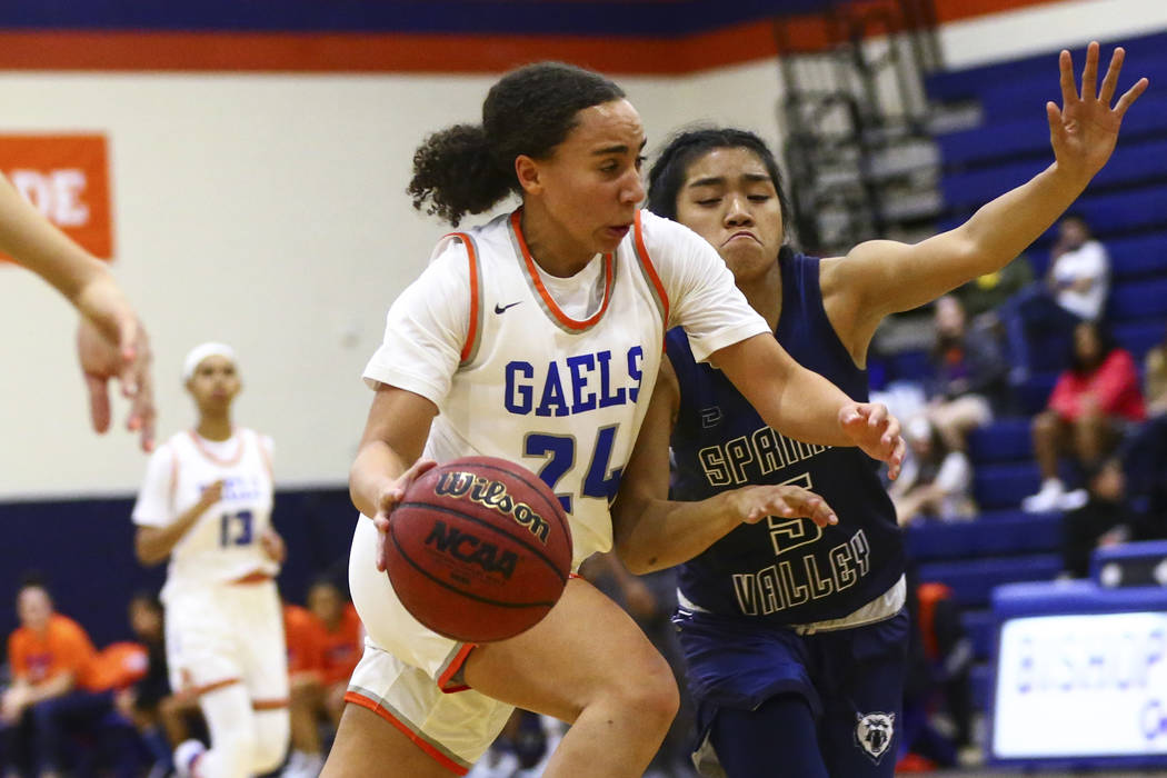 Bishop Gorman's Bentleigh Hoskins (24) drives to the basket against Spring Valley's Chelsea Cam ...