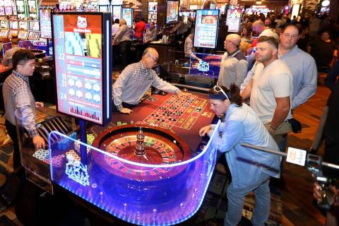 Guests play table games and machines during the opening of the MGM Springfield $960 million pro ...
