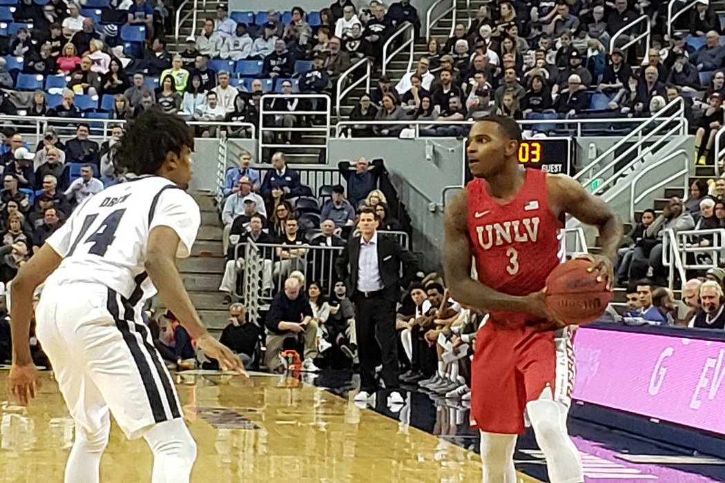 UNR's Lindsey Drew holds his ground against UNLV guard Amauri Hardy on Wednesday, Jan. 22, 2020 ...