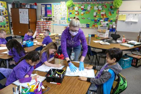 Kindergarteners participate in a class activity led by their teacher Nikki McGuire at Staton El ...
