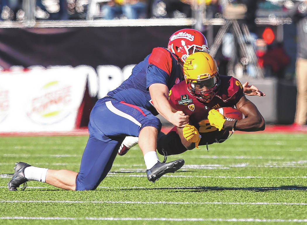 Fresno State place kicker Asa Fuller (37) tackles Arizona State wide receiver Brandon Aiyuk (2) ...