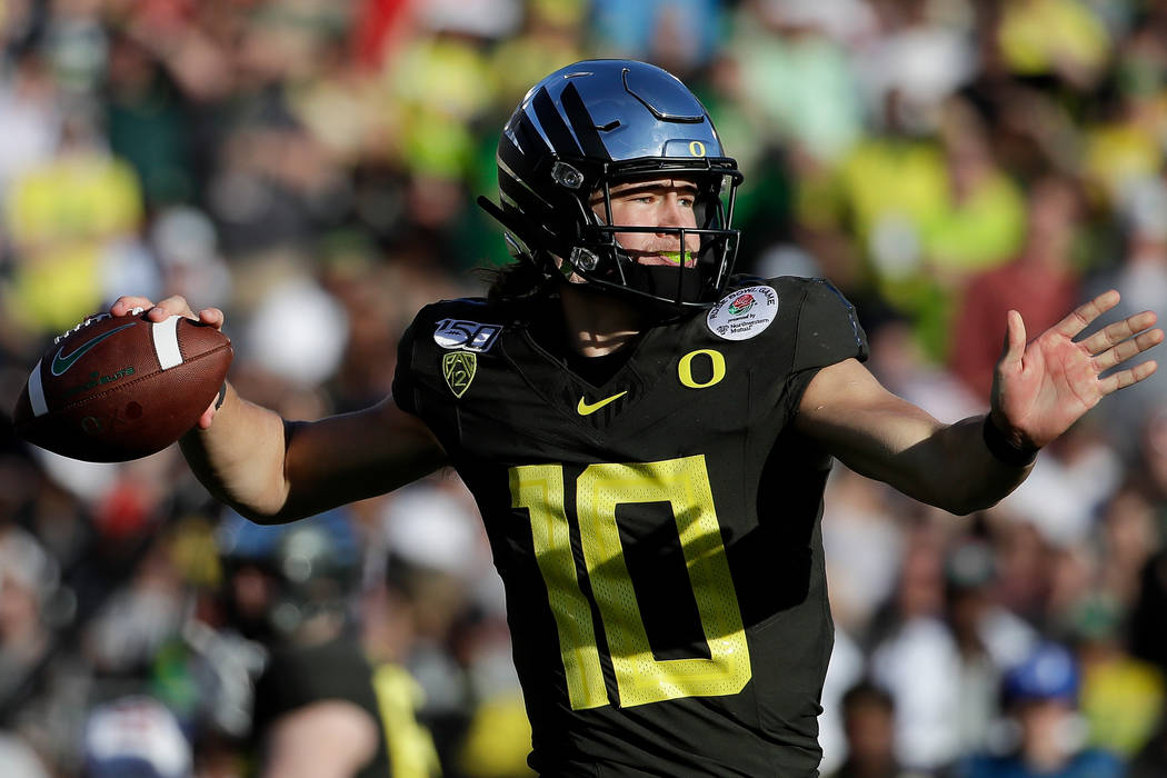 Oregon quarterback Justin Herbert passes against Wisconsin during first half of the Rose Bowl N ...