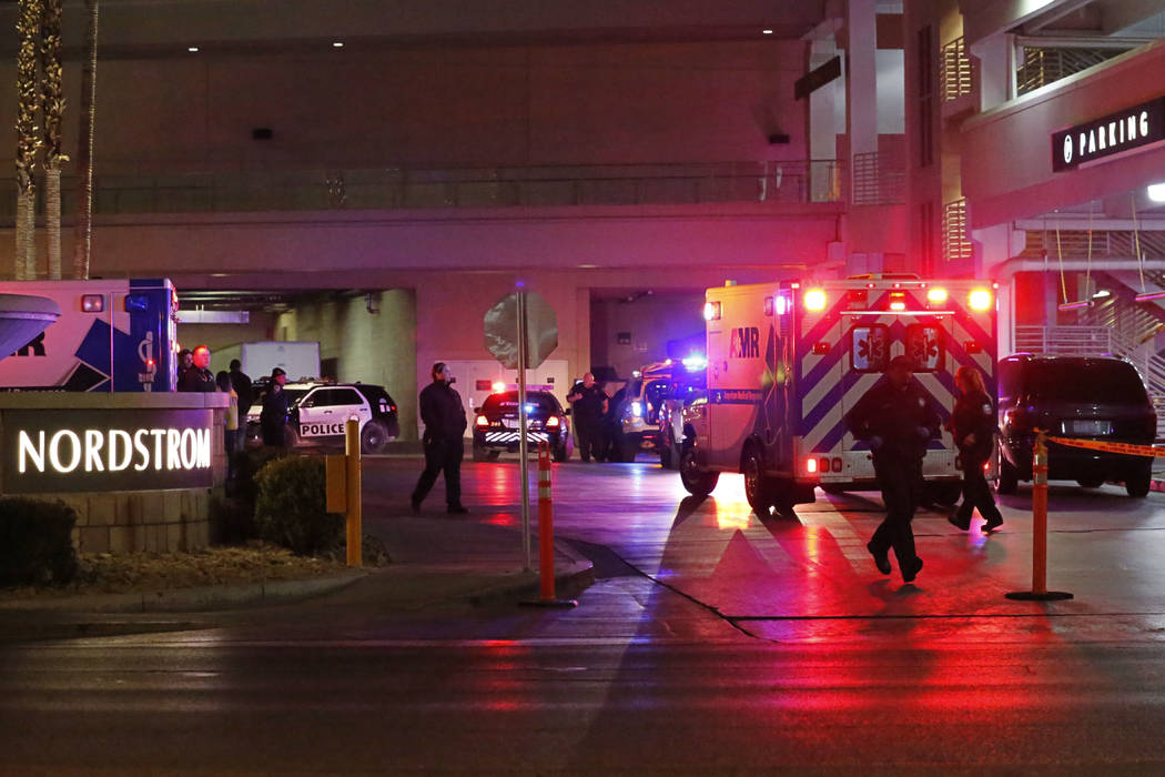 An ambulance comes out from the Nordstrom parking lot at the Fashion Show mall in Las Vegas, T ...