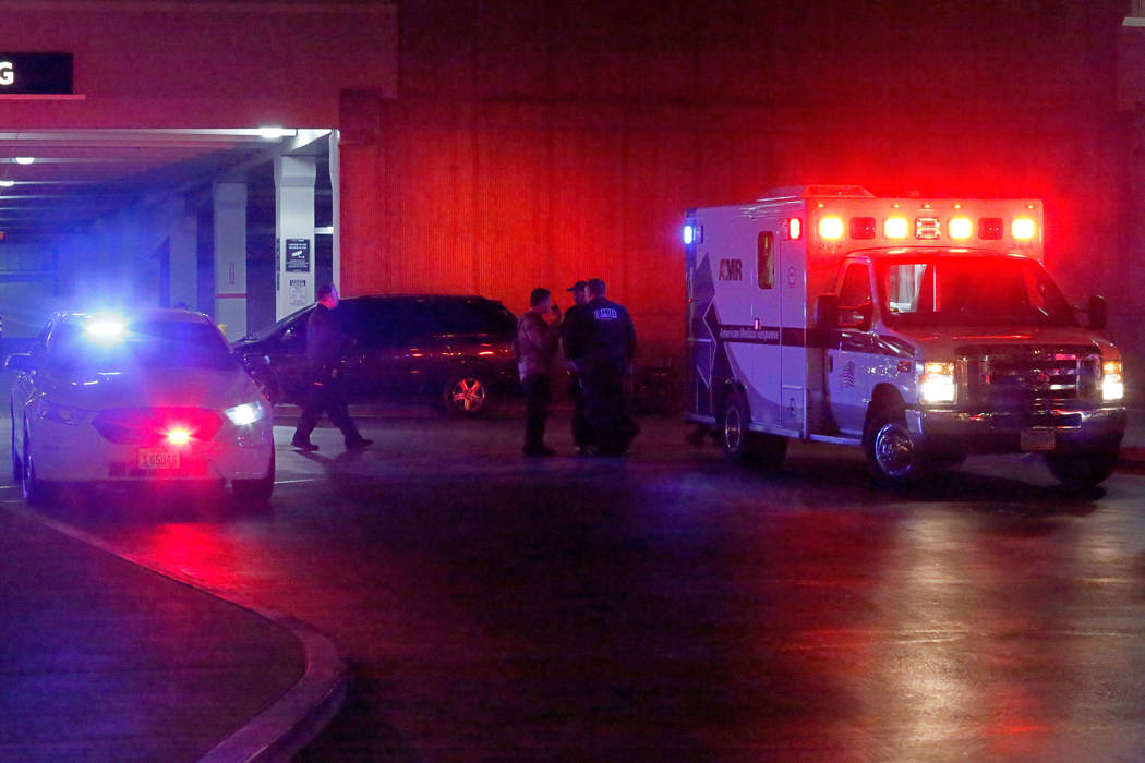An ambulance is seen in front to the Nordstrom parking lot at the Fashion Show mall in Las Veg ...