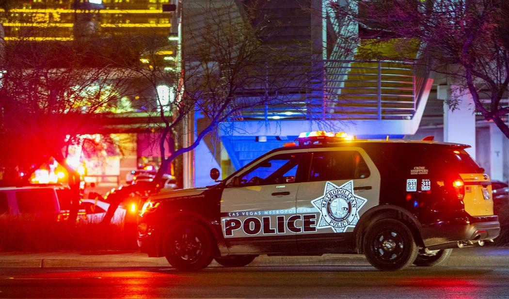 A Metropolitan Police Department officer man's a Fashion Show Mall garage entrance near Dillard ...