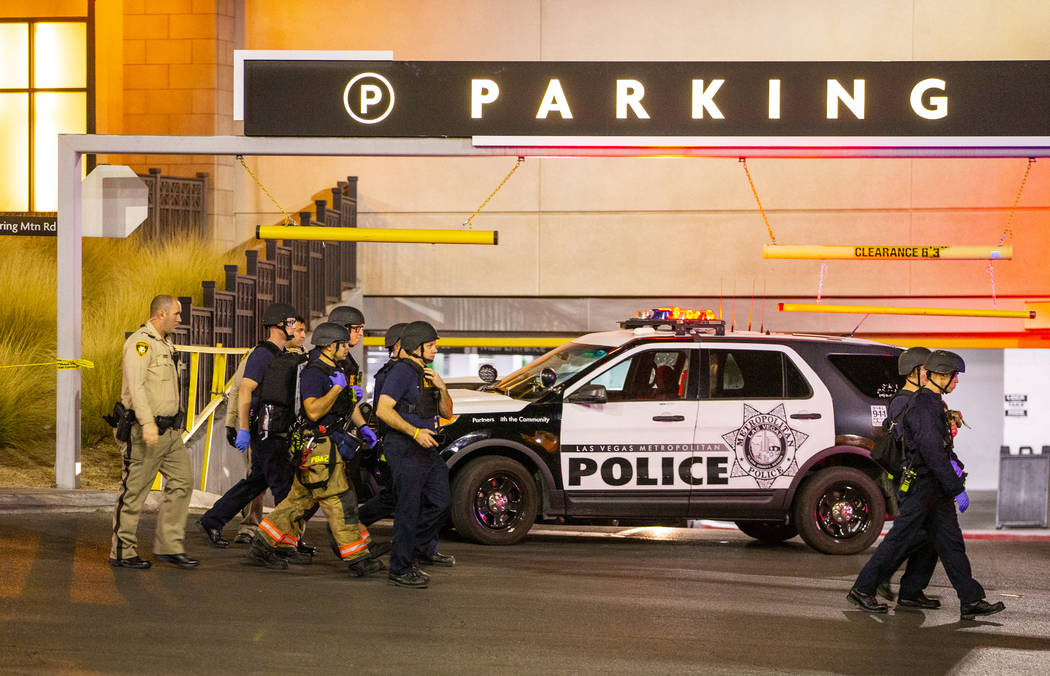 Metropolitan Police Department officers move to a Fashion Show Mall entrance near Macy's for a ...
