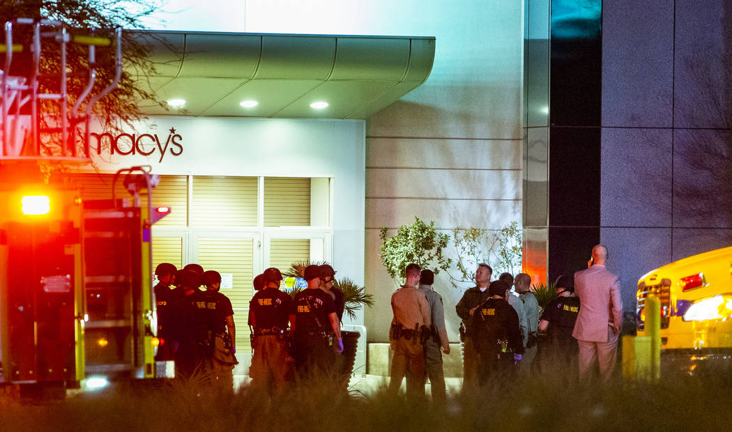 Metropolitan Police Department officers stage at a Fashion Show Mall entrance near Macy's for a ...