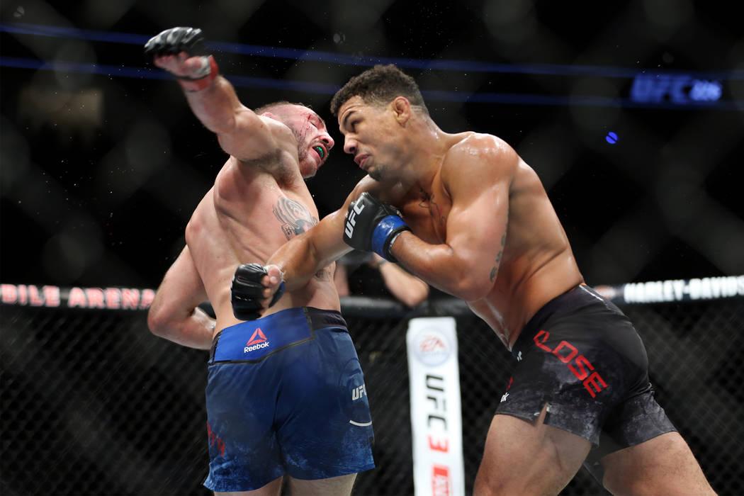 Lando Vannata, left, and Drakkar Klose battle in the lightweight bout during UFC 226 at T-Mobil ...