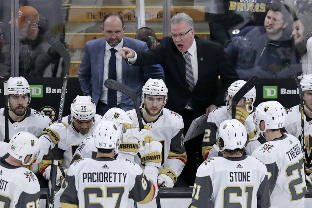 Vegas Golden Knights assistant coach Ryan McGill, right, yells at his players while head coach ...