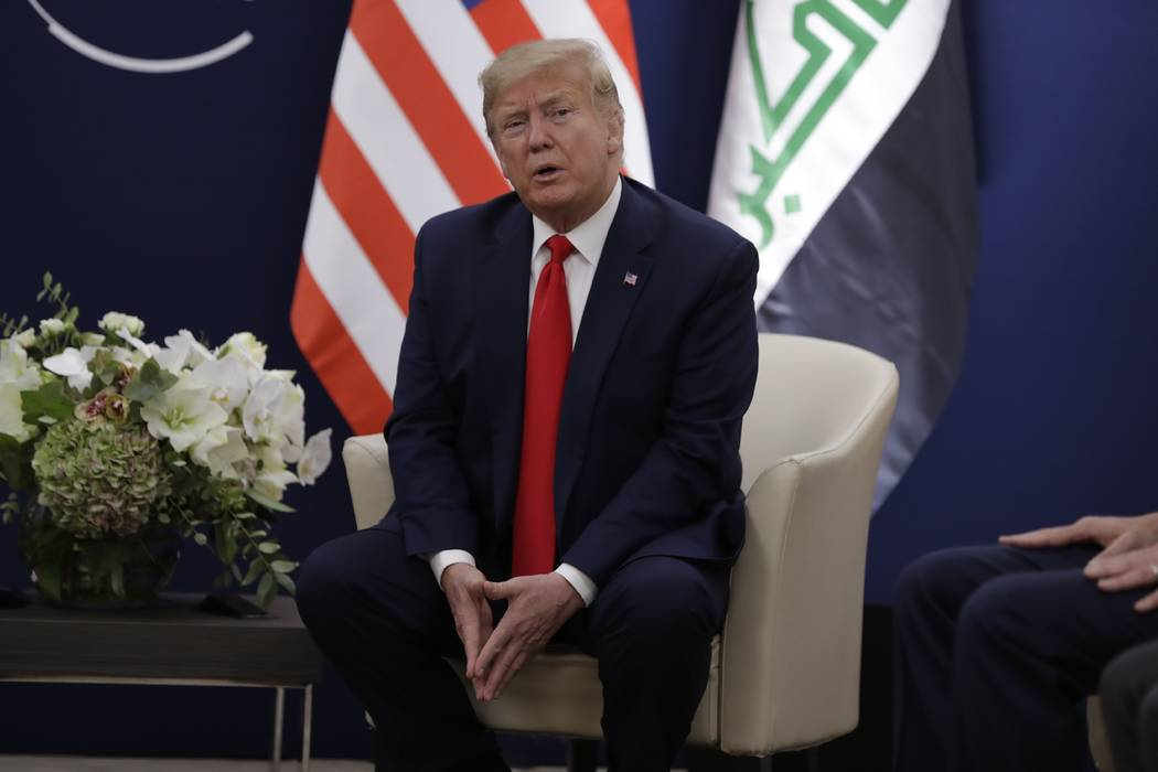 US President Donald Trump speaks during a meeting with his Iraqi counterpart Barham Salih at th ...