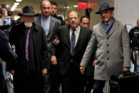 Harvey Weinstein, center, accompanied by attorney Arthur Aidala, right, arrives at court for hi ...