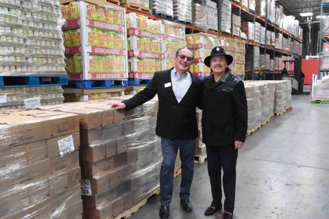 Three Square President and CEO Brian Burton and guitar legend Carlos Santana at Three Square fo ...