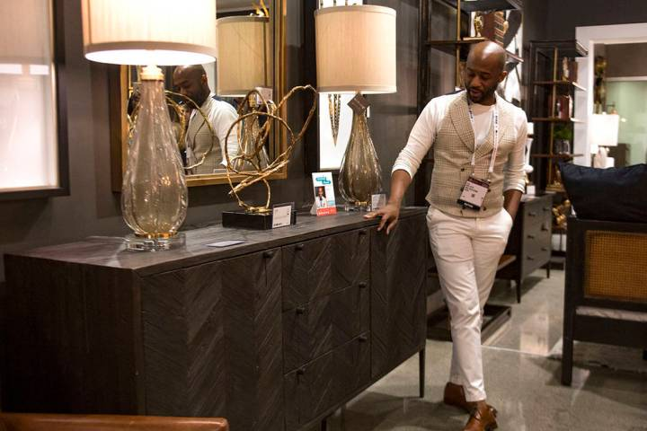 Interior designer Mikel Welch points out a gray cabinet with a black finish at the Revelation b ...