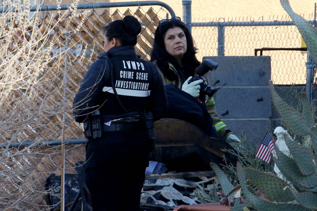 Las Vegas Metropolitan Police Department Crime scene investigators investigate after a shed fir ...