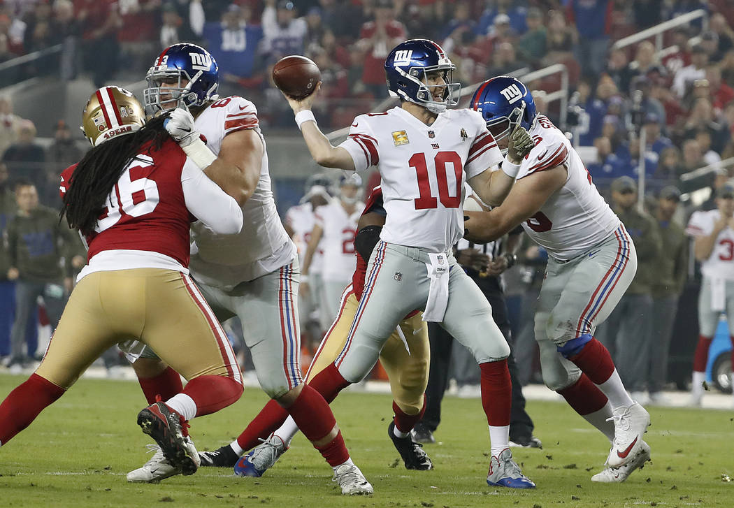 New York Giants quarterback Eli Manning (10) passes against the San Francisco 49ers during the ...