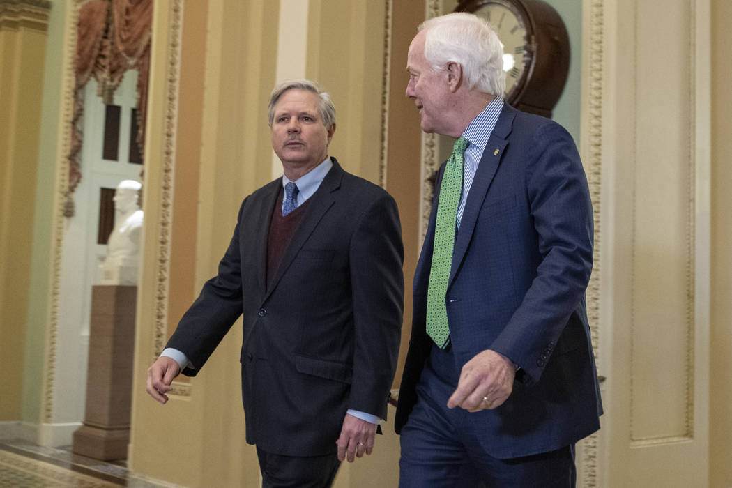 Sen. John Hoeven, R-N.D., left, talks with Sen. John Cornyn, R-Texas, as they walk to the Senat ...