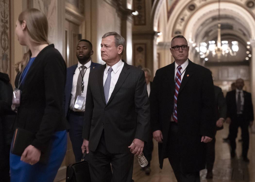 Chief Justice John Roberts departs the U.S. Capitol Wednesday, Jan. 22, 2020, following argumen ...