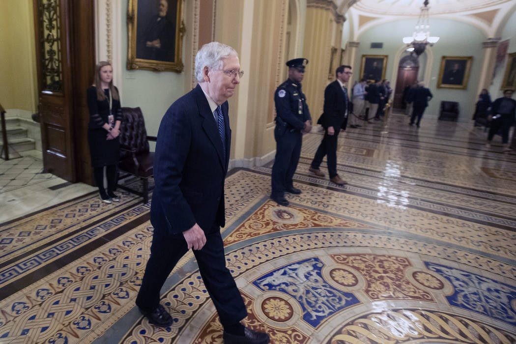 Senate Majority Leader Mitch McConnell, R-Ky., leaves the Senate chamber after the impeachment ...