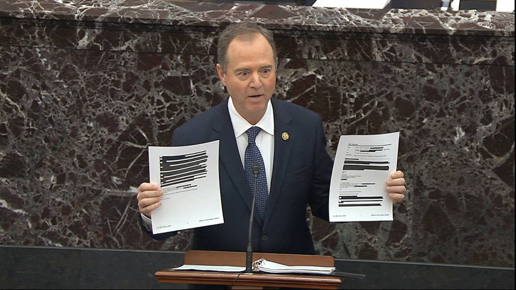 In this image from video, House impeachment manager Rep. Adam Schiff, D-Calif., holds redacted ...