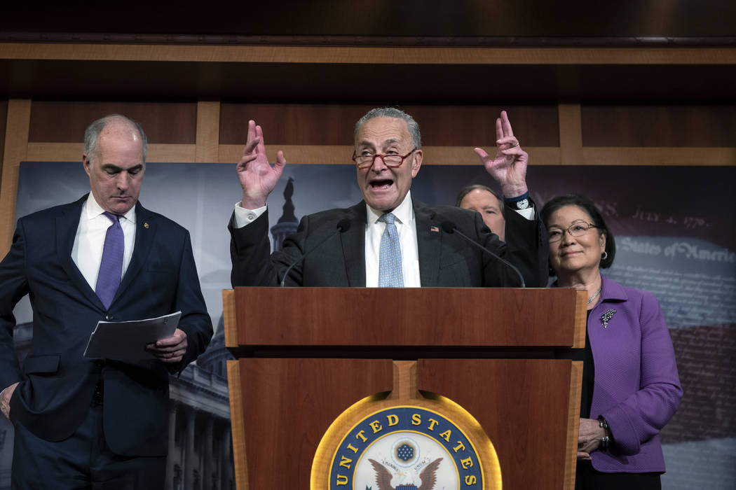 Senate Minority Leader Chuck Schumer, D-N.Y., joined from left by Sen. Bob Casey, D-Pa., Sen. T ...