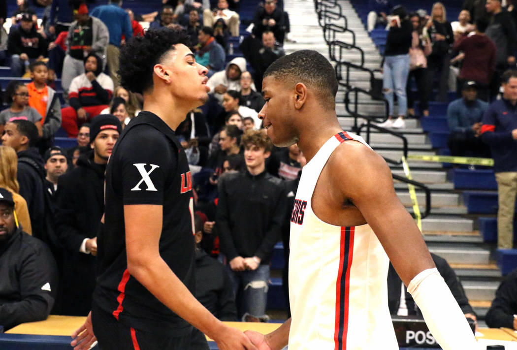 Liberty High's guard Julian Strawther, left, and Coronado High's Jaden Hardy shake hands after ...