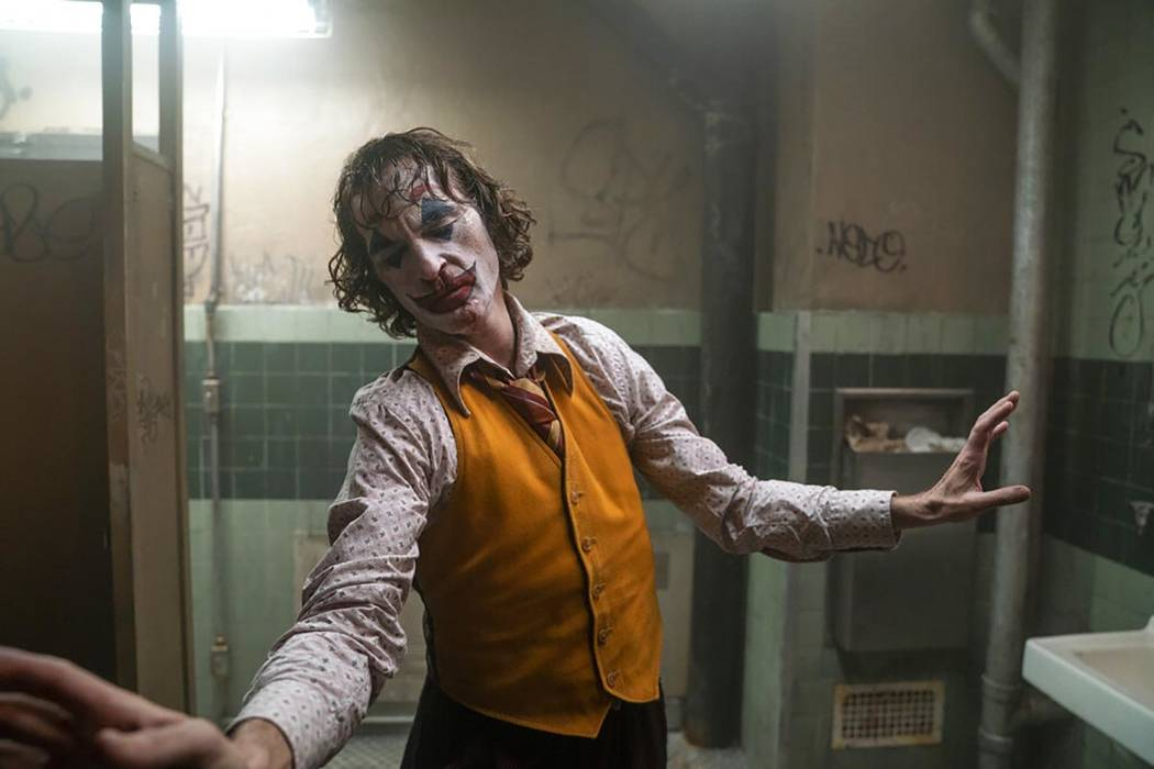 "This image released by Warner Bros. Pictures shows Joaquin Phoenix in a scene from ""Joker. ..."