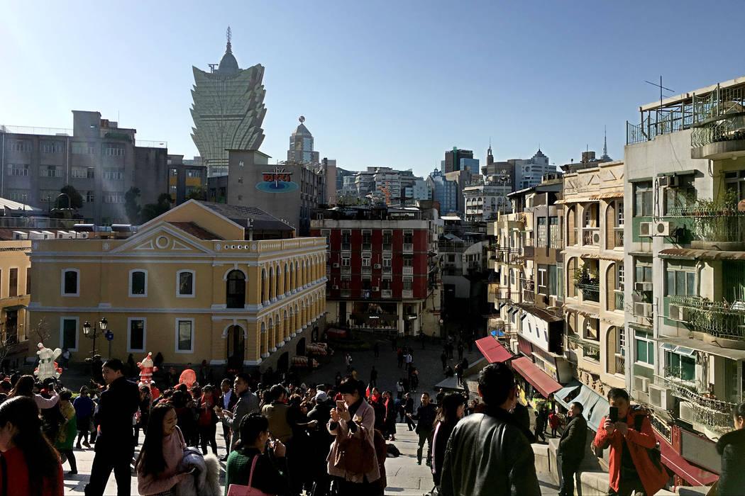 This Jan. 11, 2018, file photo shows tourists walk around the Historic Center of Macau. (Chitos ...