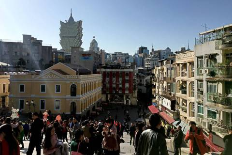 This Jan. 11, 2018, file photo shows tourists walk around the Historic Center of Macau. (Chitos ...