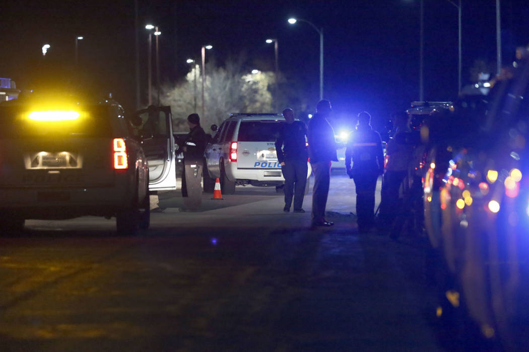 Henderson police investigate an officer-involved shooting in a residential area near Madrid Ave ...