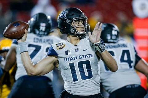 Utah State quarterback Jordan Love (10) looks to pass during the first half of the Frisco Bowl ...