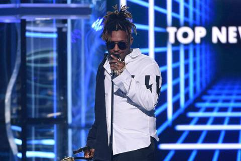 FILE - In this May 1, 2019 file photo, Juice WRLD accepts the award for top new artist at the B ...