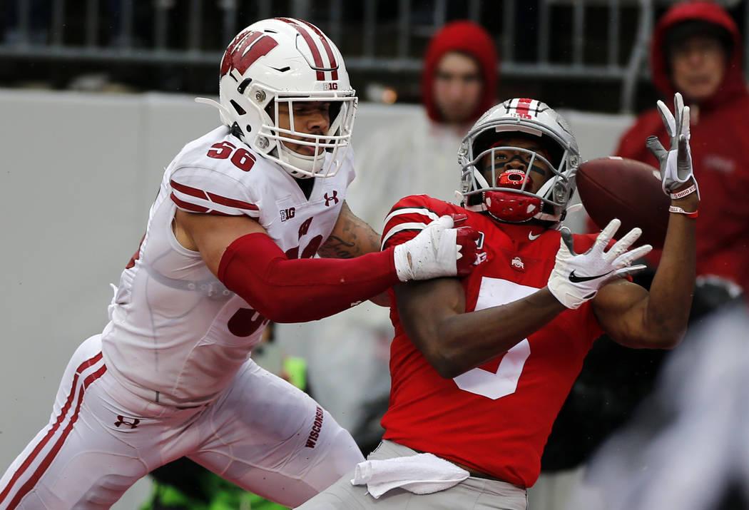 Wisconsin linebacker Zack Baun, left, interferes with Ohio State receiver Garrett Wilson during ...