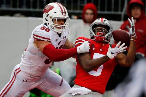 Wisconsin linebacker Zack Baun, left, interferes with Ohio State receiver Garrett Wilson during ...