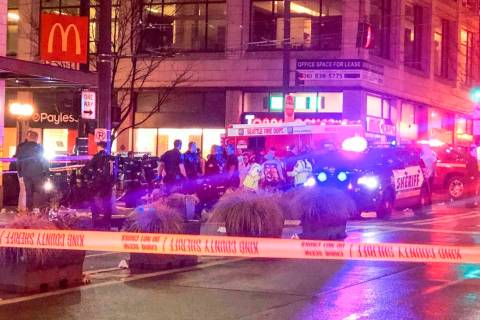Police work the scene of a shooting on Third Avenue and Pine Street, Wednesday, Jan. 22, 2020, ...