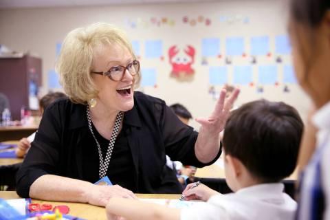 Just-retired kindergarten teacher Linda Verbon helps in a classroom at The Meadows School in La ...