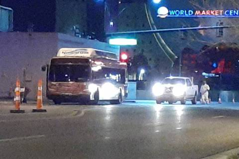 Investigators with the Metropolitan Police Department investigate a bus-pedestrian crash that k ...