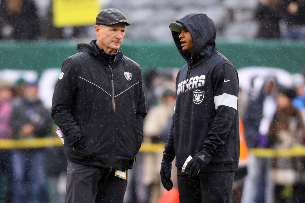 Oakland Raiders general manager Mike Mayock and safety Johnathan Abram (24) have a discussion o ...