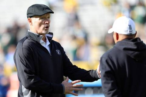 Oakland Raiders general manager Mike Mayock speaks with special team coach Rich Bisaccia before ...