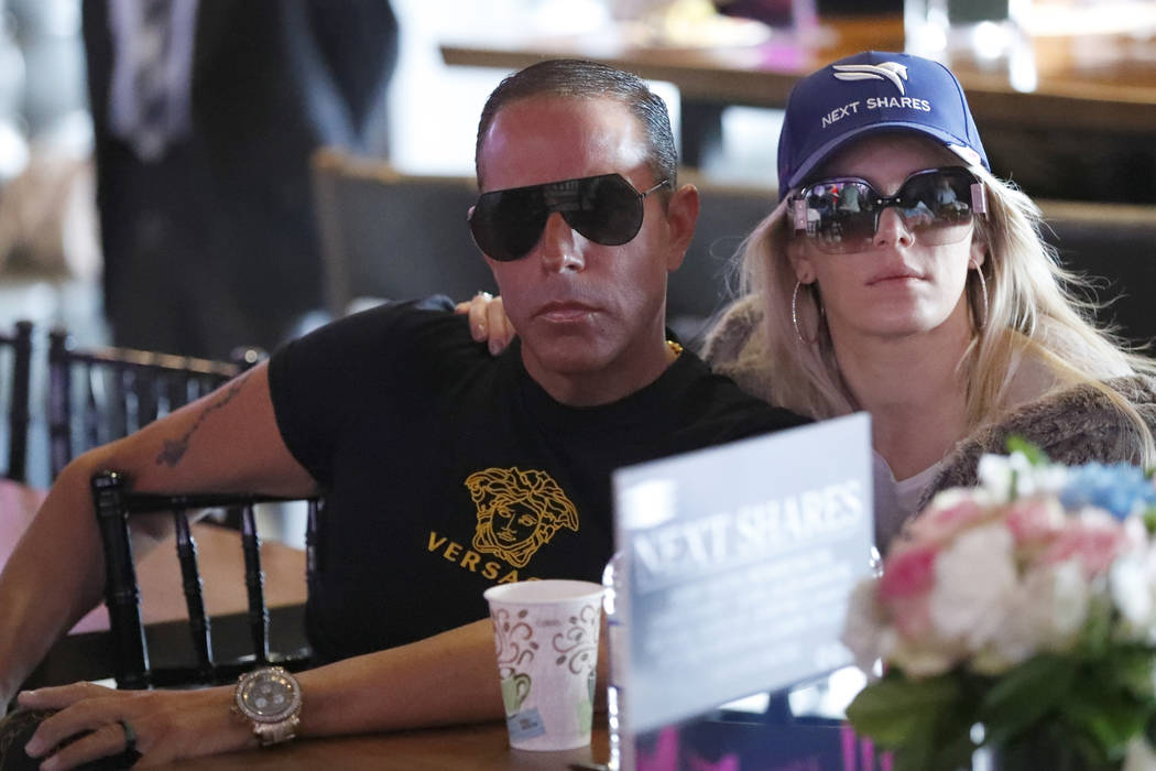 Race horse Next Shares co-owner Michael A. Iavarone and his wife Jules watch the draw for the P ...