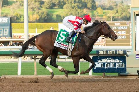 In a photo provided by Benoit Photo, Omaha Beach and jockey Mike Smith win the Grade I, $300,00 ...