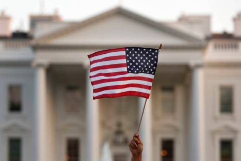 In a Sept. 2017, file photo, a flag is waved outside the White House, in Washington. The Trump ...