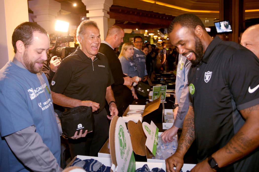 MGM employee Bill Nelson, from left, Raiders greats Jim Plunkett, from left, Steve Wisniewski a ...