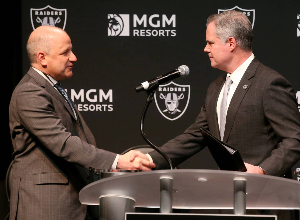 Raiders President Marc Badain, left, and Jim Murren, MGM Resorts CEO and chairman, announce a p ...