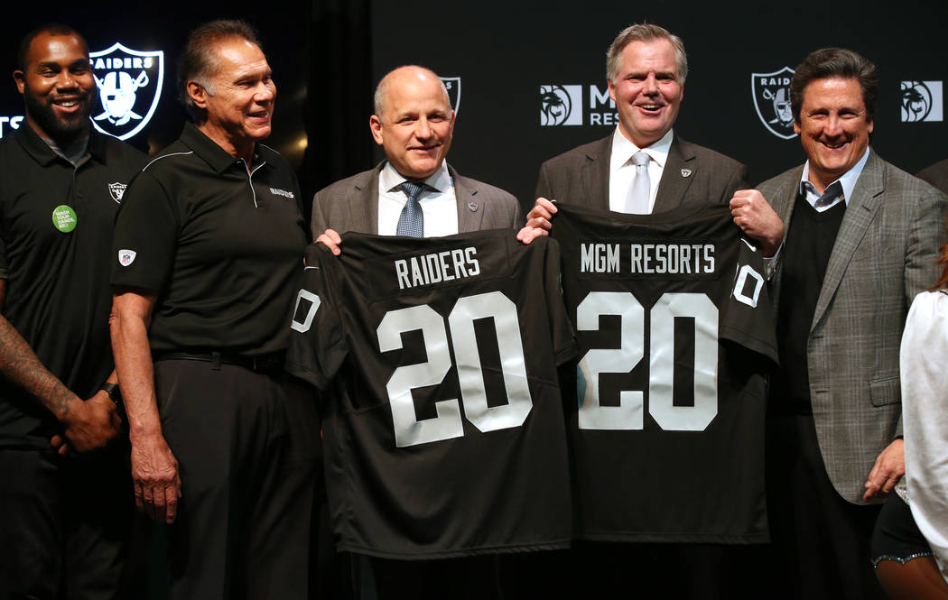 Raiders greats Darren McFadden, from left, Jim Plunkett, Raiders President Marc Badain, Jim Mur ...