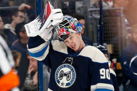 Columbus Blue Jackets' Elvis Merzlikins, of Latvia, puts his facemask on after a time out in th ...