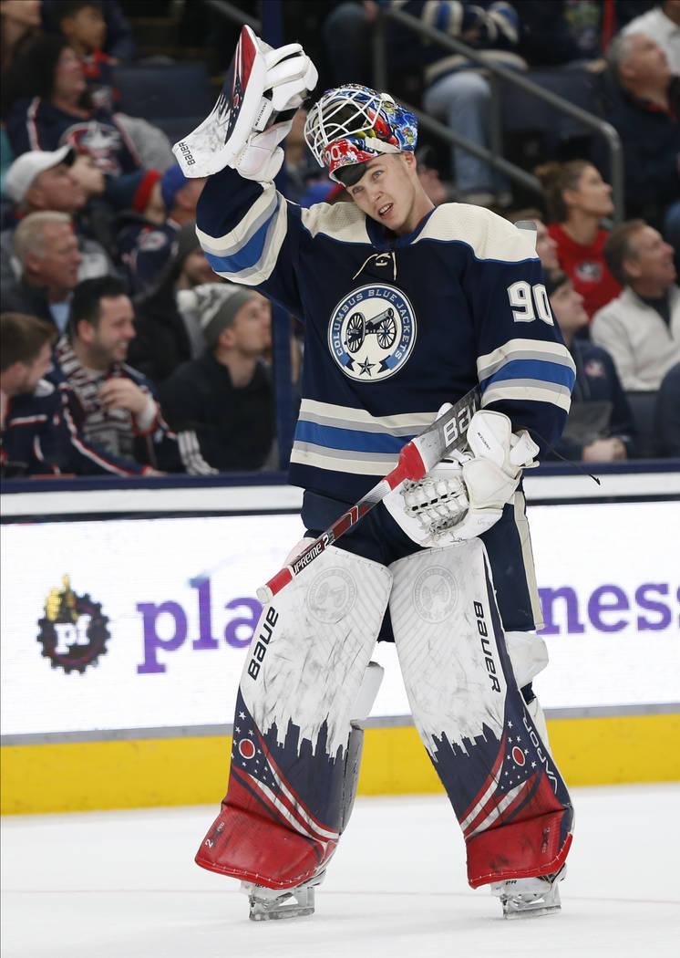 Columbus Blue Jackets' Elvis Merzlikins, of Latvia, skates back on to the ice after a time put ...