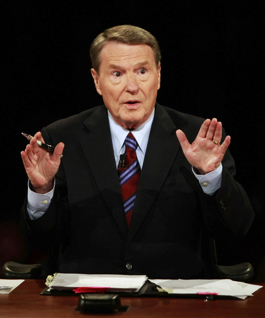 FILE - In this Sept. 26, 2008 file photo, veteran PBS anchor and debate moderator Jim Lehrer as ...