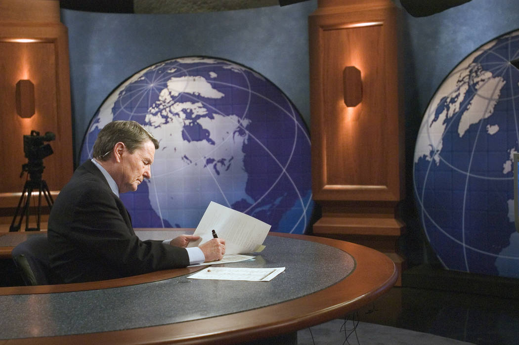 "This 2004 image released by PBS shows journalist Jim Lehrer on the set of ""PBS NewsHour wi ..."
