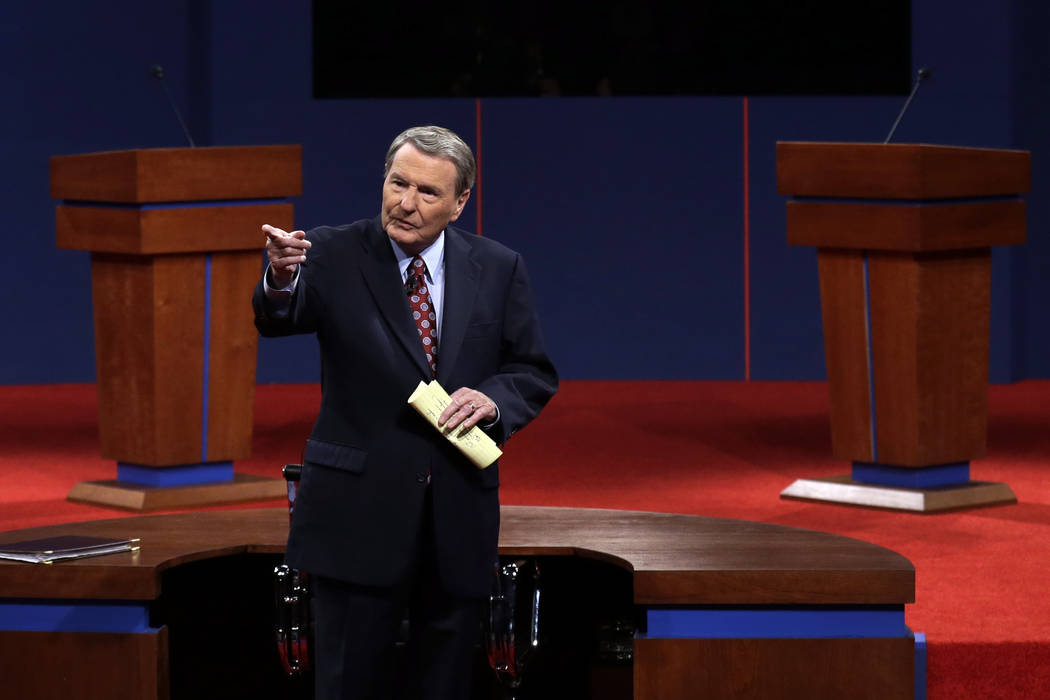 FILE - This Oct. 3, 2012 file photo shows moderator Jim Lehrer addressing the audience before t ...